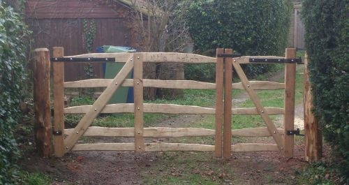 Pair of sawn Oak and cleft Chestnut  rustic Mordiford gates with blacksmith forged furniture