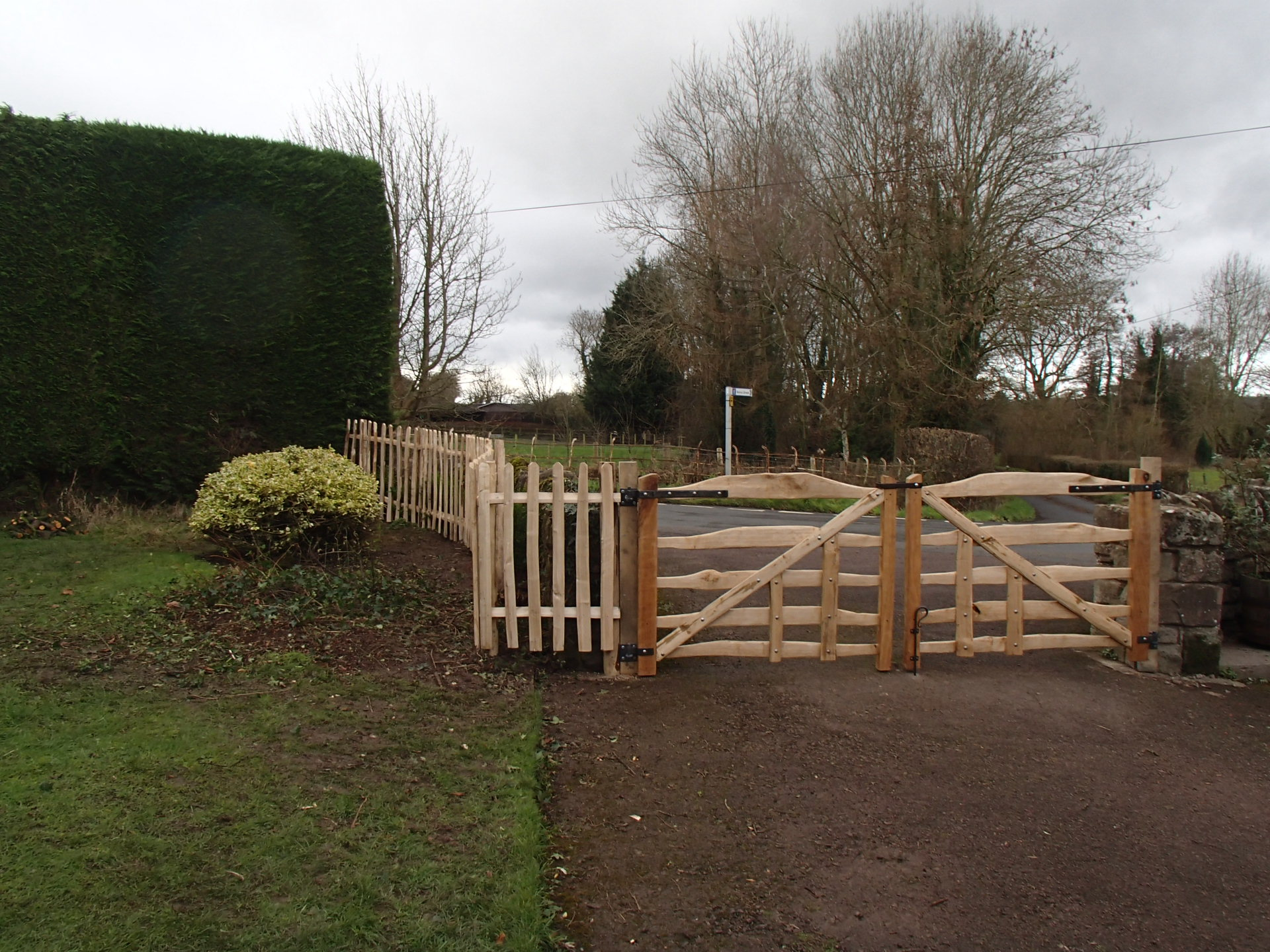 Bespoke sawn Oak and cleft Chestnut rustic gates with blacksmith forged furniture