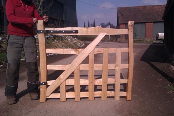 Cleft Chestnut gate with blacksmith forged furniture