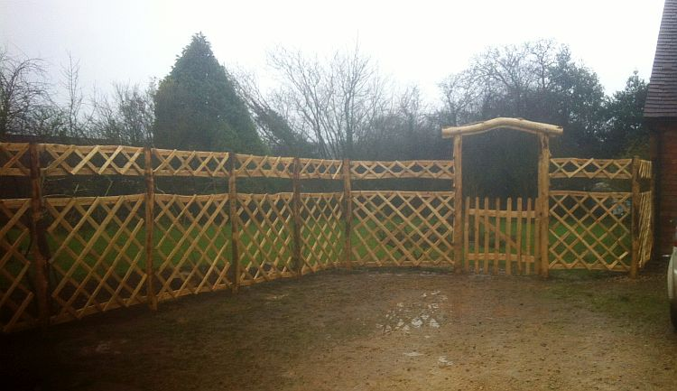Cleft Chestnut rose arch with integral gate and diamond trellis panels