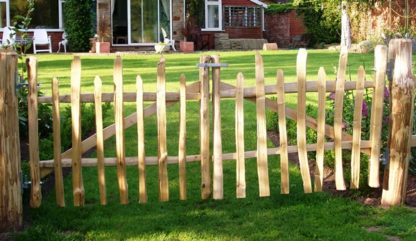 Pair of rustic cleft Chestnut wicket gates, with staggered height top