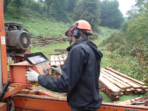 Cutting larch in a customers woodland with the woodmizer