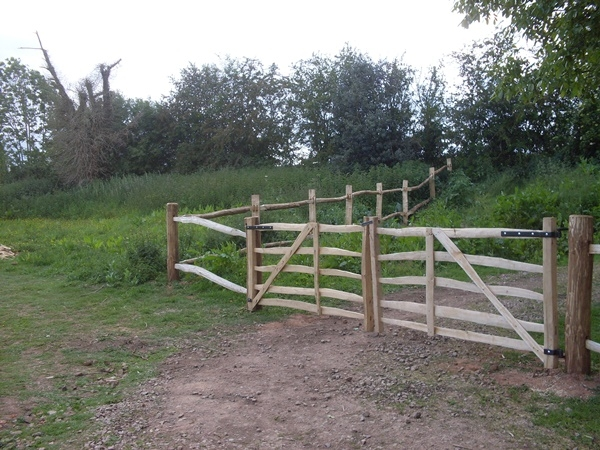 A pair of Cleft Rustic Chestnut Mordiford gates with bespoke post and rail fencing