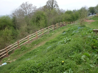 Rustic cleft Chestnut mortised post and rail fencing