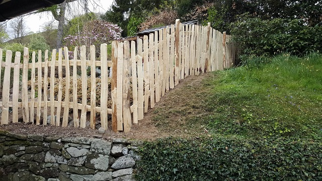 Rustic Cleft Chestnut Picket fencing works well on slopes in Herefordshire