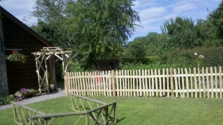 Cleft Chestnut custom designed rose arch and picket fencing