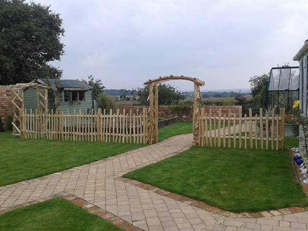 Cleft Chestnut rose arches and staggered height picket fencing