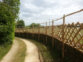 Cleft Chestnut diamond trellis panels with upper rail (to deter deer)