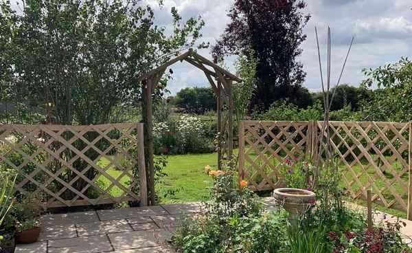 Cleft Chestnut rose arch and diamond trellis panels