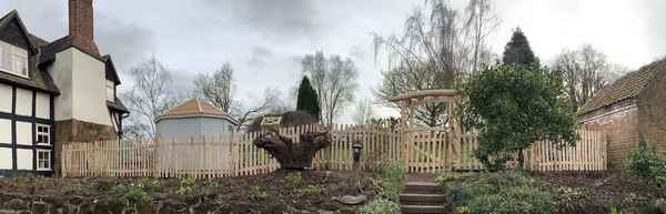 Cleft Chestnut rose arch, gate and picket fence