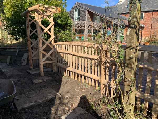 Cleft Chestnut rose arch and picket fence with hand rail