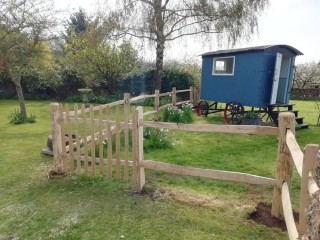 Cleft Chestnut post and rail fencing with a wicket gate