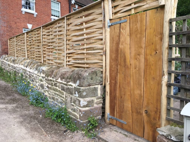 Rustic gate with lath panel above - back