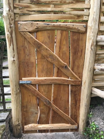 Rustic gate with lath panel above