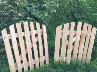 A pair of arch top cleft Chestnut wicket gates
