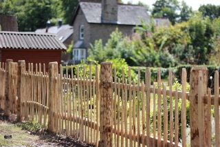 Cleft Chestnut picket fencing with staggered height pickets