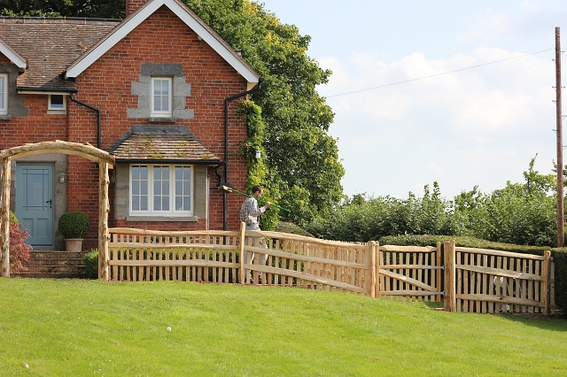 Mortise framed picket fencing with hand rail