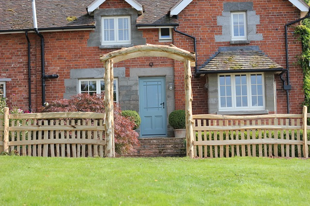 Rose arch with picket fencing with handrail