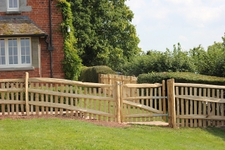 Rustic cleft Chestnut Picket fence with handrail and matching gate in Herefordshire