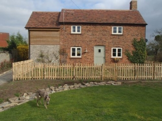 Rustic Cleft Chestnut picket fence with wicket gate