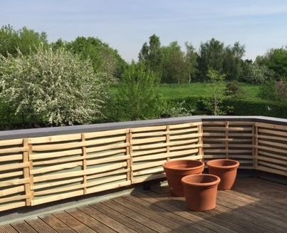 Wider spaced Chestnut cleft lath panel to soften a balcony