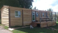 Cladding turns a static caravan into a log cabin....