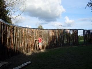 Bespoke cleft Chestnut palisade fencing with metal trim
