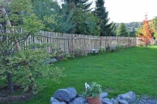 Bespoke 'bark on' cleft Chestnut fence