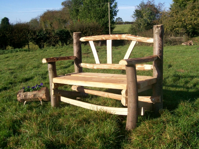 Cleft Chestnut Plato rustic bench with bark on uprights and fan back