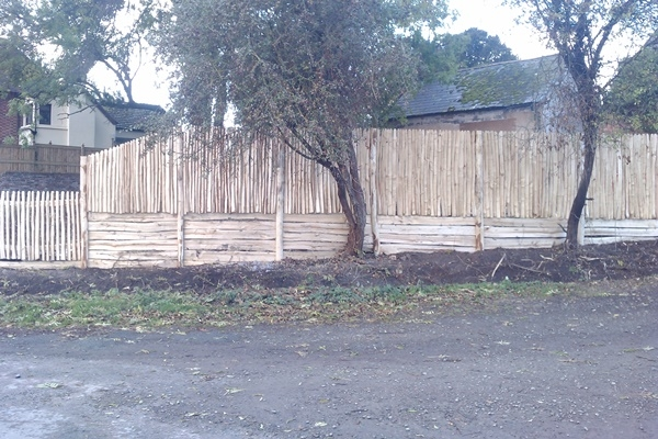 Cleft Chestnut close board fencing with gravel boards