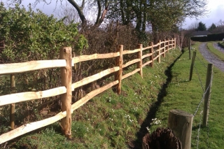 Cleft chestnut 3 rail post and rail with the posts mortised for the rails to fit through