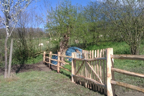 Cleft Chestnut mortised post and rail fencing with wicket gates