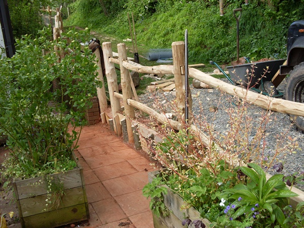 Installing mortised framed cleft Chestnut fencing