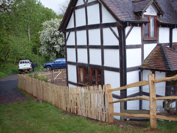 001 Cleft Chestnut mortise framed post and rail with picket fencing and wicket gate