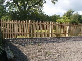 Staggered height cleft Chestnut mortise framed picket fencing