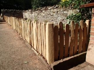 Close spaced rustic cleft oak picket fencing
