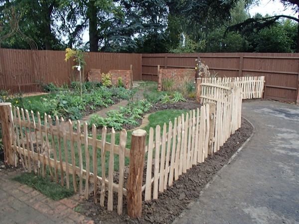 Rustic cleft Chestnut Picket fencing with a mortised frame