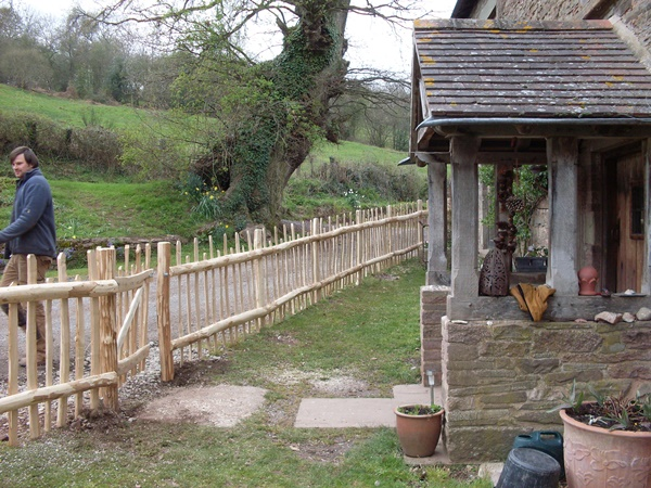 Cleft Chestnut nail framed fencing with staggered height pickets