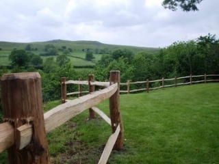 Estate grade, cleft Chestnut mortised post and rail fencing, with two rails